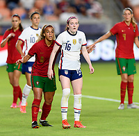 HOUSTON, TX - JUNE 10: Rose Lavelle #16 of the United States and Andreia Norton #8 of Portugal await a corner kick during a game between Portugal and USWNT at BBVA Stadium on June 10, 2021 in Houston, Texas.
