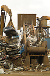 Scrap metal going into the shredder