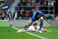 Noa Nakaitaci of France has the try awarded despite the efforts of Ben Youngs of England to push him off the pitch