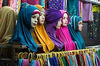Yogyakarta, Java, Indonesia.  Female Mannequins Displaying Women's Scarfs, Beringharjo Market.