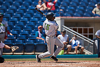 Korey Holland (15) of the Lynchburg Hillcats follows through on his swing against the Kannapolis Cannon Ballers at Atrium Health Ballpark on August 29, 2021 in Kannapolis, North Carolina. (Brian Westerholt/Four Seam Images)