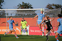 Sky Blue FC goalkeeper Jenni Branam (23) watches as Kendall Fletcher (4) heads the ball. The Western New York Flash defeated Sky Blue FC 4-1 during a Women's Professional Soccer (WPS) match at Yurcak Field in Piscataway, NJ, on July 30, 2011.