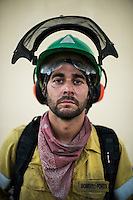 Francisco Perez Sanchez (Alora, Málaga) 35 years. Chainsaw.<br /> The firefighter from the BRICA Málaga 703, the Andalusian Service firefighting (INFOCA),  posses after a wildfire in Los Barrios near Cadiz on July 25, 2015. © Pedro ARMESTRE
