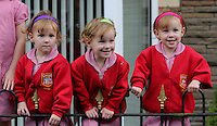 """Pictured L-R: Paige, Maddison and Ffion Gilbert <br /> Re: A set of identical triplets have been colour-coded to help teachers tell them apart on their first day in nursery school.<br /> Three-year-olds Ffion, Maddison and Paige Gilbert, are so alike even their parents struggle to know which is which.<br /> Karen and Ian Gilbert used different coloured nail-varnish on their fingers and toes to identify them when they were babies.<br /> Now the couple are using the same colours for their hair bands and bobbles at the nursery where they have just enrolled.<br /> And the colours even correspond with the names of the identical trio. <br /> Ffion has fuschia, Maddison has mint and Paige has purple.<br /> Karen, 35, of Pontypool, South Wales, said: """"We have colour-coded them since they were tiny babies - it helped us keep track of which ones had been fed.<br /> """"But nail varnish isn't allowed in school so we had come up with come other way."""