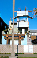 Frank Gehry: Norton House, 1982-84. 2509 Ocean Front, Venice CA. Viewing study on pole in front. (The Shinto Temple Gate is not Gehry.)  (Photo '88)