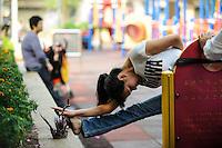 CHINA, Megacity Hong Kong, Kowloon, people doing exercise  in public park