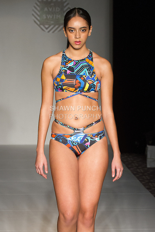 """Model walks runway in a swimsuit from the Avid Swim """"Cadiz Resort"""" 2017 collection by Gionna Nicole, on February 10, 2017 in The Stewart Hotel during Fashion Gallery New York Fashion Week Fall Winter 2017."""