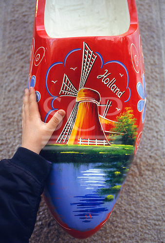 Amsterdam, Holland. Clog decorated with a picture of a windmill in red, blue and green.