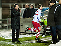 Stirling's Ross Forsyth runs right up the tunnel after Manager Stuart McLaren speaks to him after being substituted.
