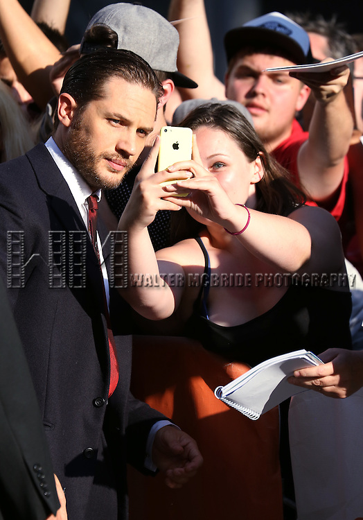 Tom Hardy greets fans as he attends the 'The Drop' premiere during the 2014 Toronto International Film Festival at Princess of Wales Theatre on September 5, 2014 in Toronto, Canada.