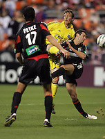 7 May 2005.  DC United's Ben Olsen (14) can't stop Domenic Mediate (28) of the Columbus Crew from shooting and scoring at RFK Stadium in Washington, DC.
