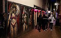 Nederland  Amsterdam  2020.   Graffiti in een steeg op de Wallen. Red Light District.    Foto : ANP/ HH / Berlinda van Dam
