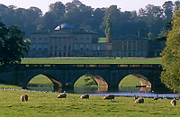A view of the north front and entrance of Kedleston Hall from across the bridge