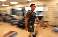 X.recovery.5.0207.jl.jpg/Marine Cpl. Michael Fox of Escondido uses a harness attached to the ceiling at the Naval Medical Center San Diego, to help teach him how the walk again /JAMIE SCOTT LYTLE/lytle@nctimes.com