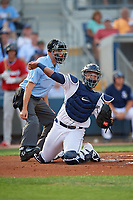 Charlotte Stone Crabs catcher Ronaldo Hernandez (27) throws the ball down to first base as umpire Jude Koury looks on during a Florida State League game against the Fort Myers Miracle on April 6, 2019 at Charlotte Sports Park in Port Charlotte, Florida.  Fort Myers defeated Charlotte 7-4.  (Mike Janes/Four Seam Images)