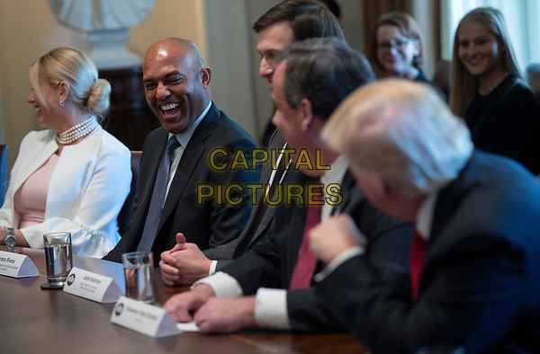 Former New York Yankee great Mariano Rivera (2-L) laughs with US President Donald J. Trump (R), about baseball during an opioid and drug abuse listening session in the Roosevelt Room of the White House in Washington, DC, USA, 29 March 2017.<br /> CAP/MPI/CNP/RS<br /> ©RS/CNP/MPI/Capital Pictures