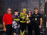 May 6, 2018; Commerce, GA, USA; NHRA top fuel driver Leah Pritchett (center) celebrates with team owner Don Schumacher (left) after winning the Southern Nationals at Atlanta Dragway. Mandatory Credit: Mark J. Rebilas-USA TODAY Sports