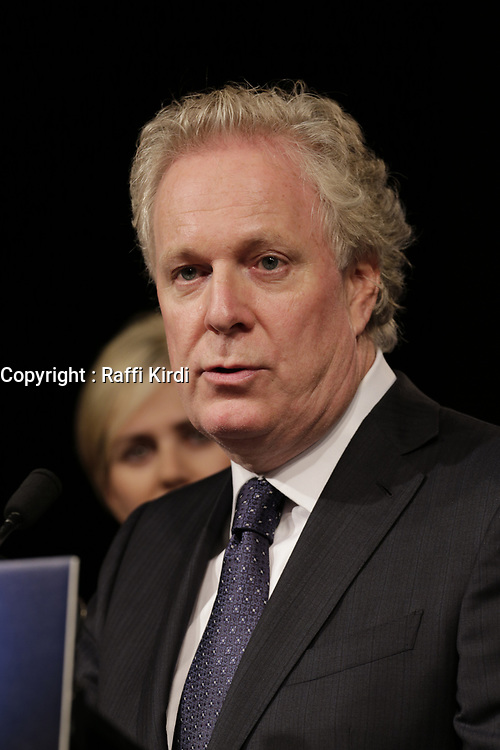 September 4, 2012 - Sherbrooke (Qc) CANADA - Quebec Premier and Liberal leader Jean Charest aknowledge loosing <br /> the Provincial election to Parti Quebecois (PQ) Leader Pauline Marois, while his wife and kids stand beside him (left)<br /> <br /> Photo (c) 2012 by Raffi Kirdi