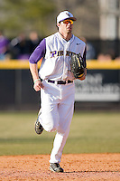 Right fielder Devin Harris #34 of the East Carolina Pirates jogs off the field between innings at Clark-LeClair Stadium on February 19, 2010 in Greenville, North Carolina.   Photo by Brian Westerholt / Four Seam Images