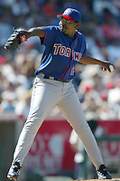 Felix Heredia of the Toronto Blue Jays pitches during a 2002 MLB season game against the Los Angeles Angels at Angel Stadium, in Anaheim, California. (Larry Goren/Four Seam Images)