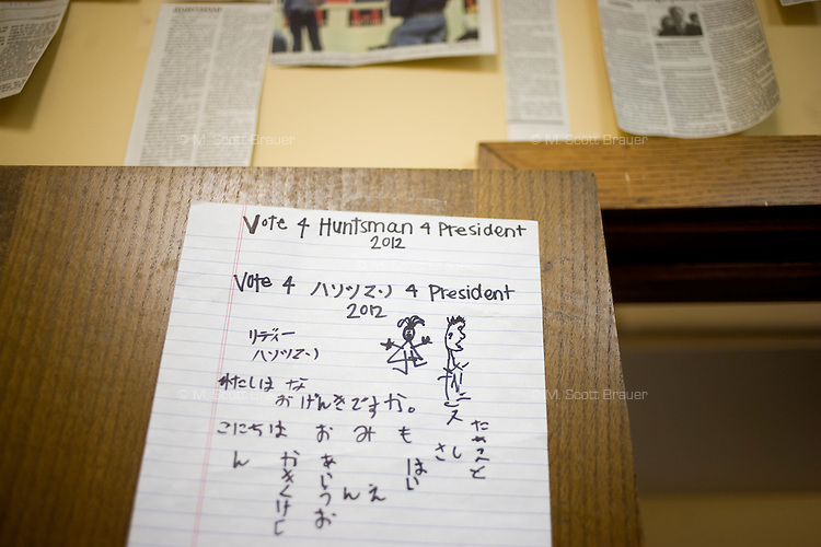 """A sign that says """"Vote 4 Huntsman 4 President 2012"""" in English and Japanese hangs on a door at the Jon Huntsman New Hampshire campaign headquarters in Manchester, New Hampshire, on Jan. 7, 2012.  Huntsman is seeking the 2012 Republican presidential nomination."""