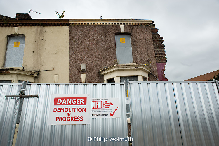 Houses being demolished in Anfield, close to Liverpool football stadium, part of a programme by the Merseyside NewHeartlands partnership, financed by the Housing Market Renewal Fund, the government strategy aimed at tackling 'low demand'.  Some long-standing residents oppose the demolition of their homes.