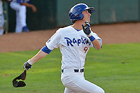 Brandon Trinkwon (9) of the Ogden Raptors hits a home run in action against the Helena Brewers at Lindquist Field on July 23, 2013 in Ogden Utah. (Stephen Smith/Four Seam Images)