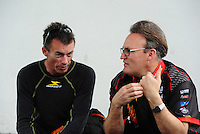 Apr. 29, 2012; Baytown, TX, USA: NHRA top fuel dragster driver Clay Millican (left) talks with Doug Kalitta during the Spring Nationals at Royal Purple Raceway. Mandatory Credit: Mark J. Rebilas-