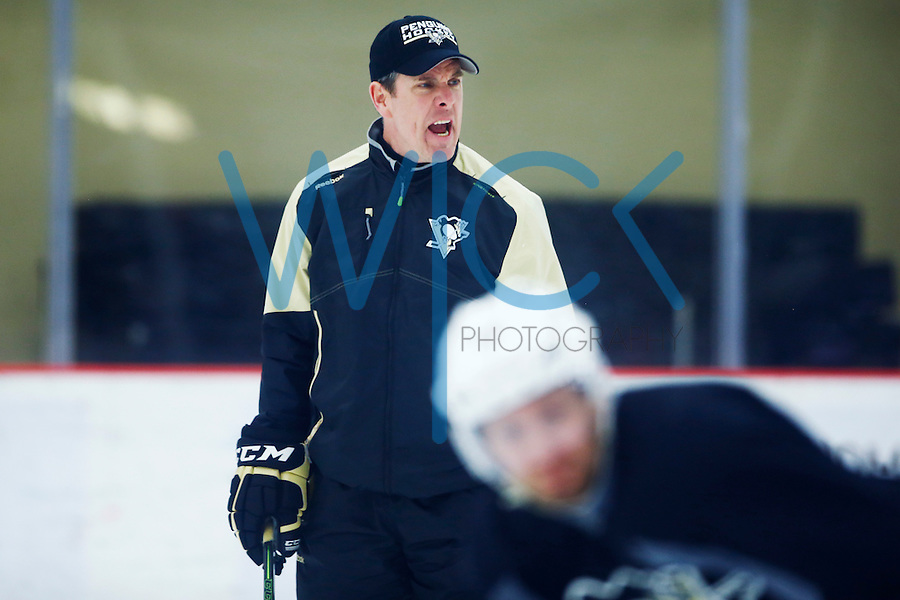 Head coach Mike Sullivan yells during practice at the Lemieux Sports Complex in Cranberry Township, PA on April 11, 2016. (Photo by Jared Wickerham / DKPS)