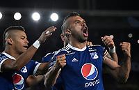 BOGOTÁ - COLOMBIA, 17-05-2018: Los jugadores de Millonarios (COL), celebran el gol anotado a Club Atlético Independiente (ARG), durante partido entre Millonarios (COL) y Club Atlético Independiente (ARG), de la fase de grupos, grupo G, fecha 5 de la Copa Conmebol Libertadores 2018, en el estadio Nemesio Camacho El Campin, de la ciudad de Bogota. / The players of Millonarios (COL), celebrate the scored goal to Club Atlético Independiente (ARG), during a match between Millonarios (COL) and Club Atletico Independiente (ARG), of the group stage, group G, 5th date for the Conmebol Copa Libertadores 2018 in the Nemesio Camacho El Campin stadium in Bogota city. VizzorImage / Luis Ramirez / Staff.