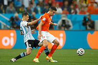 Robin van Persie of the Netherlands and Martin Demichelis of Argentina