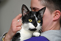 Pictured: Rebecca pictured with Oscar.<br /> A cat named Oscar has been returned home after going missing since before last Christmas. Oscar was returned from Kent more than 200 miles from his home in Caerau, Cardiff. His owners Danielle, 27, and Rebecca, 28, Spencer are thrilled he has come home. They are urging all pet lovers to have their animals micro chipped .