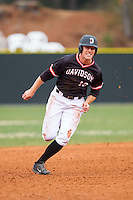 Forrest Brandt (10) of the Davidson Wildcats hustles towards third base against the Wake Forest Demon Deacons at Wilson Field on March 19, 2014 in Davidson, North Carolina.  The Wildcats defeated the Demon Deacons 7-6.  (Brian Westerholt/Four Seam Images)