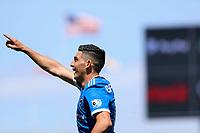 SAN JOSE, CA - APRIL 24: Cristian Espinoza #10 of the San Jose Earthquakes scores a goal and celebrates during a game between FC Dallas and San Jose Earthquakes at PayPal Stadium on April 24, 2021 in San Jose, California.