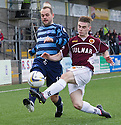 Forfar's Martyn Fotheringham is challenged by Stenny's Sean Dickson.