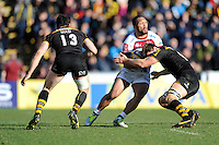 Johnny Leota of Sale Sharks is tackled during the Aviva Premiership match between London Wasps and Sale Sharks at Adams Park on Saturday 1st March 2014 (Photo by Rob Munro)