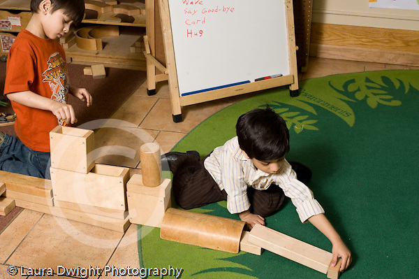 Education Preschool 3-5 year olds block area two boy building long construction together horizontal
