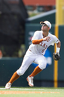 Texas Longhorns shortstop CJ Hinojosa (9) on defense during the NCAA Super Regional baseball game against the Houston Cougars on June 7, 2014 at UFCU Disch–Falk Field in Austin, Texas. The Longhorns are headed to the College World Series after they defeated the Cougars 4-0 in Game 2 of the NCAA Super Regional. (Andrew Woolley/Four Seam Images)