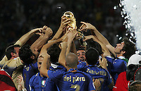 The Italian team celebrates with the trophy after the game.  Italy defeated France on penalty kicks after leaving the score tied, 1-1, in regulation time in the FIFA World Cup final match at Olympic Stadium in Berlin, Germany, July 9, 2006.