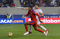 Harrison, NJ - Thursday March 01, 2018: Carlo Costly, Aaron Long. The New York Red Bulls defeated C.D. Olimpia 2-0 (3-1 on aggregate) during a 2018 CONCACAF Champions League Round of 16 match at Red Bull Arena.