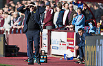 Hearts v St Johnstone…19.03.16  Tynecastle, Edinburgh<br />Tommy Wright struggles to see against the bright sun<br />Picture by Graeme Hart.<br />Copyright Perthshire Picture Agency<br />Tel: 01738 623350  Mobile: 07990 594431