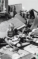 1990 FILE PHOTO - ARCHIVES -<br /> <br /> Clearing up: Amber Doupe; 8; left; and Monica Ruston; 10; gather up books yesterday after a tornado hit the village of Frome Tuesday.<br /> <br /> 1990<br /> <br /> PHOTO :  Erin Comb - Toronto Star Archives - AQP