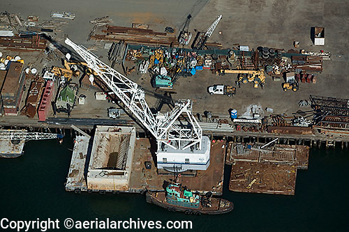 aerial photograph of a crane on a barge docked at Port of Oakland, California