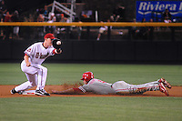 May 8, 2008; Phoenix, AZ, USA; Arizona Diamondbacks shortstop Stephen Drew (left) attempts to tag out Philadelphia Phillies base runner Eric Bruntlett during the game at Chase Field. Mandatory Credit: Mark J. Rebilas-
