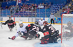 Sochi, RUSSIA - Mar 9 2014 -  Graeme Murray clears the way in front of Corbin Watson during Canada vs. Norway at the 2014 Paralympic Winter Games in Sochi, Russia.  (Photo: Matthew Murnaghan/Canadian Paralympic Committee)