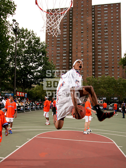 Brandon Jennings (3) goes up for a dunk during the Elite 24 Hoops Classic game on September 1, 2006 held at Rucker Park in New York, New York.  The game brought together the top 24 high school basketball players in the country regardless of class or sneaker affiliation.