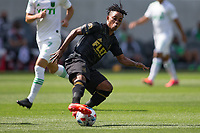 LOS ANGELES, CA - APRIL 17: Latif Blessing #7 of LAFC reaches for a ball during a game between Austin FC and Los Angeles FC at Banc of California Stadium on April 17, 2021 in Los Angeles, California.