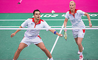 28 JUL 2012 - LONDON, GBR - Chris Adcock (GBR) of Great Britain returns during the London 2012 Olympic Games mixed doubles group badminton match with partner Imogen Bankier (GBR) against Alexandr Nikolaenko and Valeria Sorokina of Russia at Wembley Arena, London, Great Britain (PHOTO (C) 2012 NIGEL FARROW)