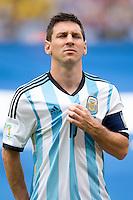 Lionel Messi of Argentina pulls at his shirt