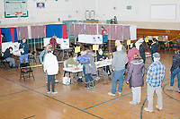 People vote in the New Hampshire Presidential Primary at Fair Grounds Junior High School in Nashua, New Hampshire, on Tue., Feb. 11, 2020.